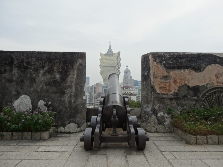 Cannons overlook the Grand Lisboa Casino in Macau.